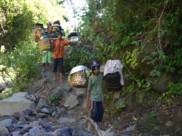 The porters of Mount Rinjani on flip flop carry heavy load